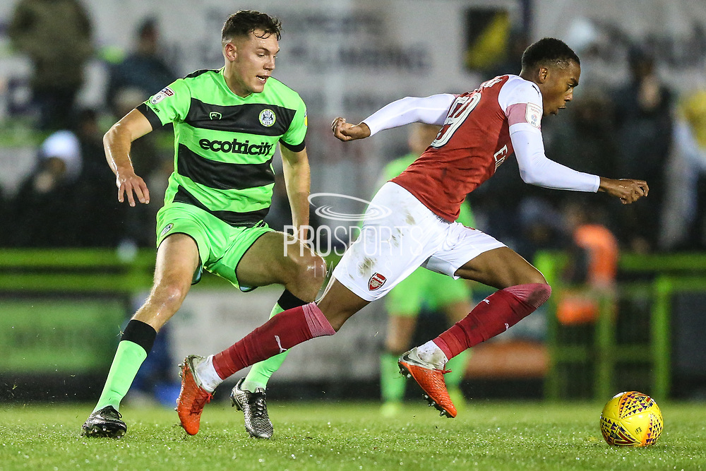 Arsenal's Joe Willock(59) runs past Forest Green Rovers Paul Digby(20) during the EFL Trophy group stage match between Forest Green Rovers and U21 Arsenal at the New Lawn, Forest Green, United Kingdom on 7 November 2018.