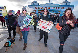 "© Licensed to London News Pictures. 08/02/2020. Weston-super-Mare, North Somerset, UK. ""No Bristol Airport Expansion"" weekend of protest in Weston-super-Mare, where North Somerset Council will decide on Monday 10 February whether to approve expansion plans for Bristol Airport which is situated in the local authority area of North Somerset. Events included a model ostrich with its head in the sand, joined by 100 other XR protestors with their heads in the sand. Bristol Airport Action Network (BAAN) is staging a 3 day peaceful vigil outside the Town Hall that will lead up to and include the time of the Planning Committee meeting on Monday at 6pm. Events include a beach art action, street theatre, and protest march. The event is co-hosted by Extinction Rebellion groups from Weston, Bristol and other groups around the region who oppose the expansion of Bristol Airport. Bristol Airport, situated in North Somerset, has plans to increase capacity for 12 million passengers a year, up from its current capacity of 10 million by 2026, and their application is due to be considered at a special meeting of North Somerset's Planning and Regulatory Committee on February 10. North Somerset Council officers have recommended the application be approved despite more than 5,400 objections and around 2,200 letters of support. Objections have highlighted the detrimental effects for the local communities including increased air and noise pollution, increased traffic congestion and the loss of Greenbelt land around the airport, but the urgent need to tackle climate change is one of the main reasons why people are objecting. Photo credit: Simon Chapman/LNP."