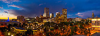 Panoramic view of downtown skyline with City & County Building on left, Civic Center Park in foreground and Colorado State Capitol on right, Denver, Colorado USA.