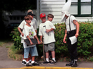 Local teenagers are confronted by a member of the Ku Klux Klan on Brownsville Road in Brentwood.  About a dozen members of the Klan spent an hour leafleting Brownsville Road during rush hour.