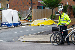 © Licensed to London News Pictures. 02/06/2015. London, UK. Police officers investigating a scene where a 75 year old man died following collision with a vehicle in Tooting, south London on Tuesday, 2 June 2015. Two men were arrested after on suspicion after fleeing the scene in a vehicle. Photo credit: Tolga Akmen/LNP