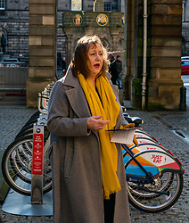 City Chambers, Edinburgh, Scotland, United Kingdom, Just Eat E-bikes: A new fleet of 163 rentable e-bikes are launched and integrated into the capital's existing cycle hire scheme by Just Eat Cycles. Edinburgh will now have the largest docked e-bike fleet in UK. Pictured: Councillor Lesley McInnes, Transport and environment convener, launches the e-bike scheme.<br /> Sally Anderson | EdinburghElitemedia.co.uk