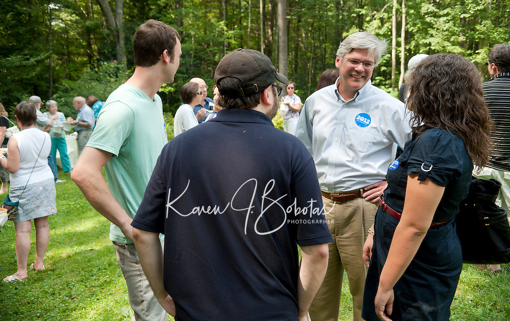 Andrew Hosmer chats with guests at an informal BBQ in Canterbury for the Merrimack County Democrats Sunday afternoon.  (Karen Bobotas/for the Concord Monitor)Merrimack County Democrats backyard BBQ in Canterbury, NH  August 21, 2011.