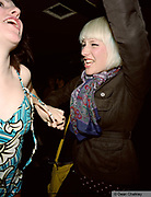 Two girls dancing, enjoying themselves at The Junk Club, Southend, UK 2006