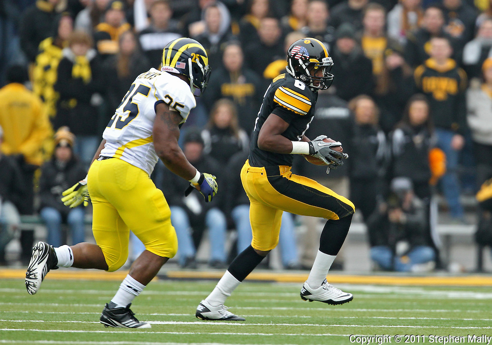 November 05, 2011: Iowa Hawkeyes wide receiver Keenan Davis (6) pulls in a pass as Michigan Wolverines linebacker Kenny Demens (25) defends during the first quarter of the NCAA football game between the Michigan Wolverines and the Iowa Hawkeyes at Kinnick Stadium in Iowa City, Iowa on Saturday, November 5, 2011. Iowa defeated Michigan 24-16.