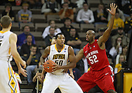 January 04 2010: Iowa Hawkeyes forward Jarryd Cole (50) looks to pass the ball as Ohio State Buckeyes forward Dallas Lauderdale (52) defends during the second half of an NCAA college basketball game at Carver-Hawkeye Arena in Iowa City, Iowa on January 04, 2010. Ohio State defeated Iowa 73-68.
