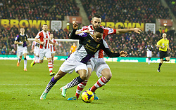 STOKE-ON-TRENT, ENGLAND - Sunday, January 12, 2014: Liverpool's is brought down for a penalty by Stoke City's Marc Wilson during the Premiership match at the Britannia Stadium. (Pic by David Rawcliffe/Propaganda)