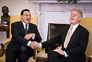 US President Bill Clinton laughs with Egyptian President Hosni Mubarak during a meeting in the Oval Office of the White House, July 1, 1999. The two leaders met privately behind closed doors looking for a lasting peace solution in the Middle East.