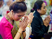 14 APRIL 2019 - DES MOINES, IOWA: People pray during Lao New Year, also called Songkran,  observances at Wat Lao Buddhavath in Des Moines. Several thousand Lao people live in Des Moines. Most came to the US after the wars in Southeast Asia. Songkran is celebrated in Theravada Buddhist countries (Sri Lanka, Myanmar, Thailand, Laos, and Cambodia) and in Theravada Buddhist communities around the world.         PHOTO BY JACK KURTZ