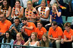 07-09-2013 VOLLEYBAL: EK VROUWEN DUITSLAND - NEDERLAND: HALLE<br /> Nederland verliest met 3-2 van Duitsland / Oranje support publiek met Joelle Staps, Edzo Doeve en Martin Kersbergen<br /> &copy;2013-FotoHoogendoorn.nl