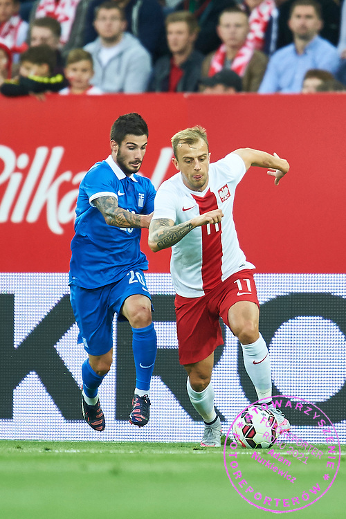(R) Kamil Grosicki from Poland fights for the ball with (R) Taxiarchis Fountas from Greece during international friendly soccer match between Poland and Greece at PGE Arena Stadium on June 16, 2015 in Gdansk, Poland.<br /> Poland, Gdansk, June 16, 2015<br /> <br /> Picture also available in RAW (NEF) or TIFF format on special request.<br /> <br /> For editorial use only. Any commercial or promotional use requires permission.<br /> <br /> Adam Nurkiewicz declares that he has no rights to the image of people at the photographs of his authorship.<br /> <br /> Mandatory credit:<br /> Photo by &copy; Adam Nurkiewicz / Mediasport