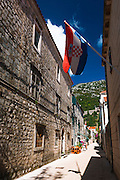 Narrow street and Croatian flag, Ston, Dalmatian Coast, Croatia