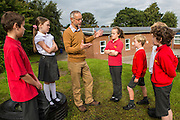Richard of Lymm Community Energy discussing the solar panel output with the school eco team. Lymm Community Energy has a number of solar panels on top of Ravenbank county primary school.