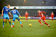 Crawley Town forward Karlan Ahearne-Grant gets past Grimsby Town defender Zak Mills (12) before scoring his goal (score 2-0) during the EFL Sky Bet League 2 match between Crawley Town and Grimsby Town FC at the Checkatrade.com Stadium, Crawley, England on 10 February 2018. Picture by Andy Walter.