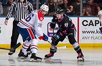 KELOWNA, BC - SEPTEMBER 21: Jack Finley #26 of the Spokane Chiefs looks for puck after winning the face off against Kyle Topping #24 of the Kelowna Rockets  at Prospera Place on September 21, 2019 in Kelowna, Canada. (Photo by Marissa Baecker/Shoot the Breeze)