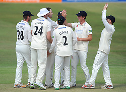 Gloucestershire celebrate as Rob Keogh of Northamptonshire is out for LBW bowled by James Fuller of Gloucestershire - Photo mandatory by-line: Dougie Allward/JMP - Mobile: 07966 386802 - 09/07/2015 - SPORT - Cricket - Cheltenham - Cheltenham College - LV=County Championship 2