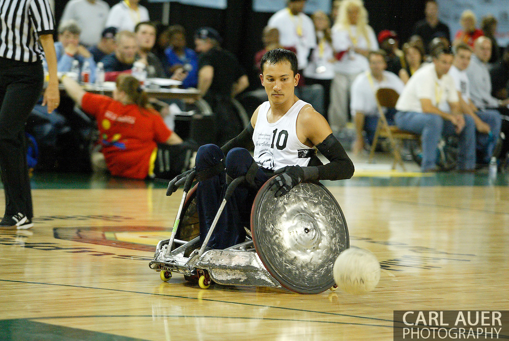 July 7th, 2006: Anchorage, AK - William Groulx rolls along with the ball as White defeated Blue in the gold medal game of Quad Rugby at the 26th National Veterans Wheelchair Games.