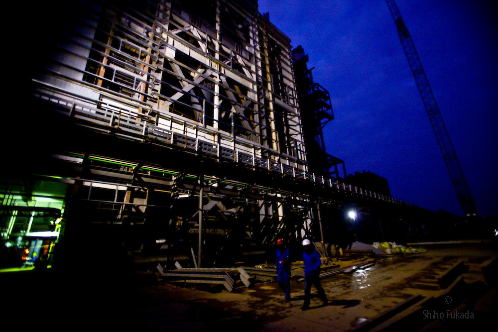 The Haiphong Thermal Power Plant construction site at night in Trung Son, Vietnam, Nov. 21, 2009. Dongfang Electric, a large Chinese contractor, and Marubeni, a Japanese company, won the $500-million contract in 2005. China, famous for its export of cheap goods, is increasingly known around the world for shipping out cheap labor.