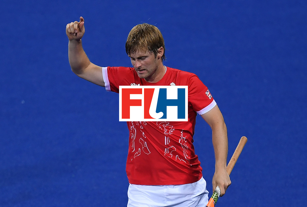 Britain's Ashley Jackson celebrates scoring a goal during the men's field hockey Brazil vs Britain match of the Rio 2016 Olympics Games at the Olympic Hockey Centre in Rio de Janeiro on August, 9 2016. / AFP / MANAN VATSYAYANA        (Photo credit should read MANAN VATSYAYANA/AFP/Getty Images)