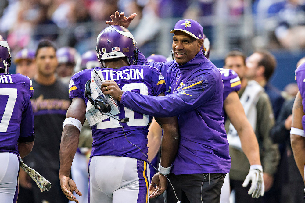 ARLINGTON, TX - NOVEMBER 3:  Head Coach Leslie Frazier congratulates Adrian Peterson #28 of the Minnesota Vikings after a touchdown against the Dallas Cowboys at  AT&T Stadium on November 3, 2013 in Arlington, Texas.  The Cowboys defeated the Vikings 27-23.  (Photo by Wesley Hitt/Getty Images) *** Local Caption *** Adrian Peterson; Leslie Frazier