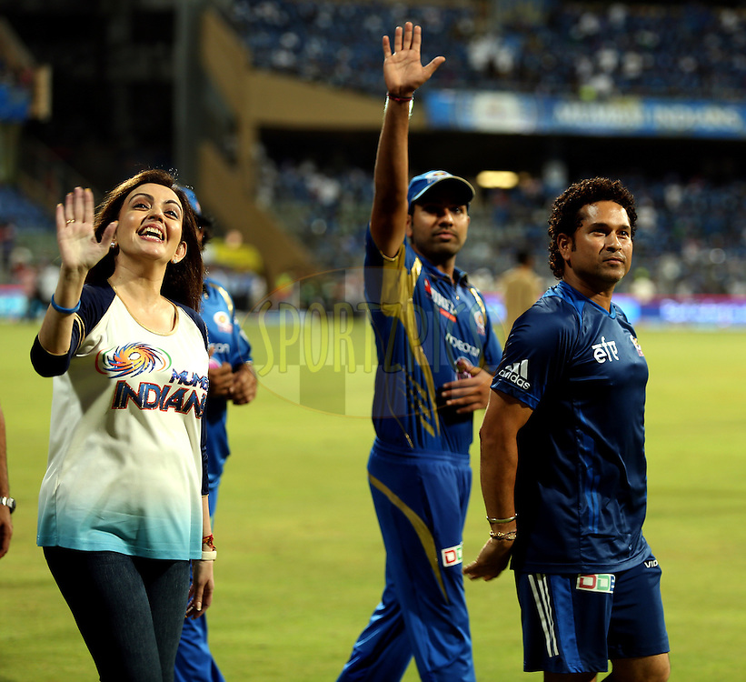 Nita Ambani owner of Mumbai Indians  Sachin Tendulkar Icon of MUmbai Indians and Rohit Sharma captain of of the Mumbai Indians take a a lap of the ground  after the match  22 of the Pepsi Indian Premier League Season 2014 between the Mumbai Indians and the Kings XI Punjab held at the Wankhede Cricket Stadium, Mumbai, India on the 3rd May  2014<br /> <br /> Photo by Sandeep Shetty / IPL / SPORTZPICS<br /> <br /> <br /> <br /> Image use subject to terms and conditions which can be found here:  http://sportzpics.photoshelter.com/gallery/Pepsi-IPL-Image-terms-and-conditions/G00004VW1IVJ.gB0/C0000TScjhBM6ikg
