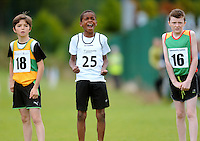 13 Aug 2016:  Ola Amoo, centre, from Kildare, cheers on his team-mate as he waits to run the anchor leg of the U12 Mixed Distance relay, with Tadhgh O'Neill, right, from Carlow, and Elijah McGinley, from Donegal, left.  2016 Community Games National Festival 2016.  Athlone Institute of Technology, Athlone, Co. Westmeath. Picture: Caroline Quinn