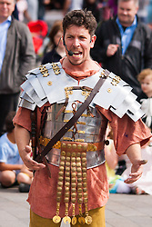 "Granary Square, Kings Cross, London, August 30th 2014.  A ""Roman Centurian"" entertains the crowds at Granary Square, King's Cross, during Battle Bridge: Boudicca Vs The Romans, which brings alive the ancient history associated with the area. PAYMENT/CONTACT DETAILS: paul@pauldaveycreative.co.uk Tel +44 (0) 7966 016 296 or +44 (0) 208 969 6875"