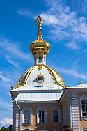 Peterhof, Russia -- July 21, 2019. Vertical photo of a golden spire  on the Summer Palace in Peterhof, Russia.