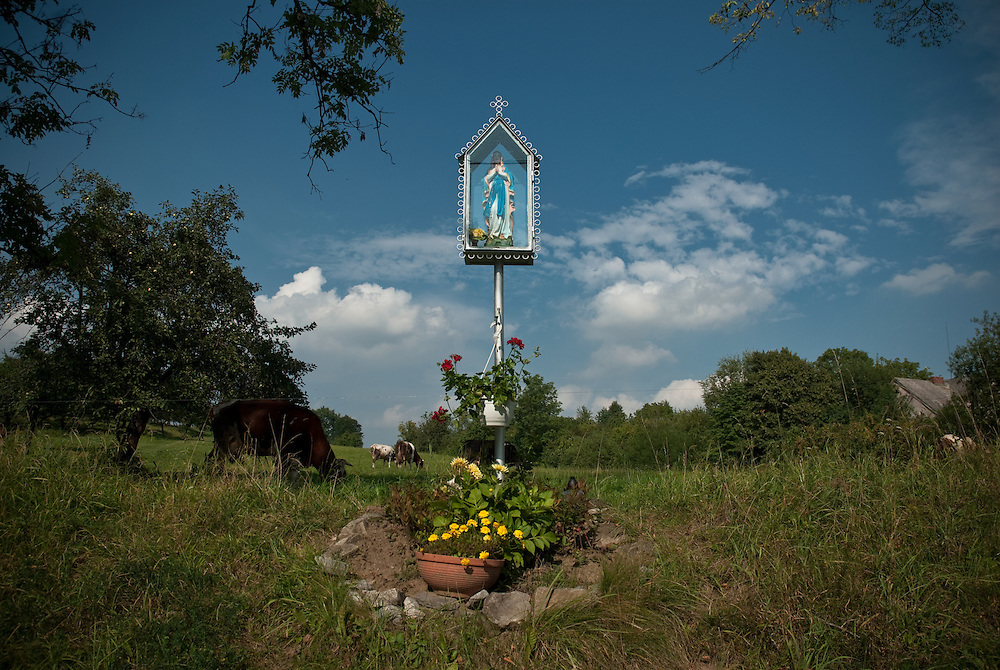 A roadside shrine in Punców, Beskidy, Silesia, Poland. August 2009.