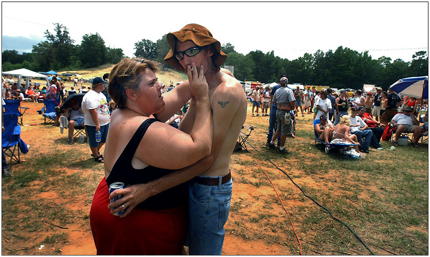 East Dublin, Ga. - July 9, 2005: Tabitha and Preston Wright of Eastmman, Ga. dance during a bread in the games at The Tenth Annual Summer Redneck Games in East Dublin, Ga. July 9. 2005. (Photo/Stephen Morton)