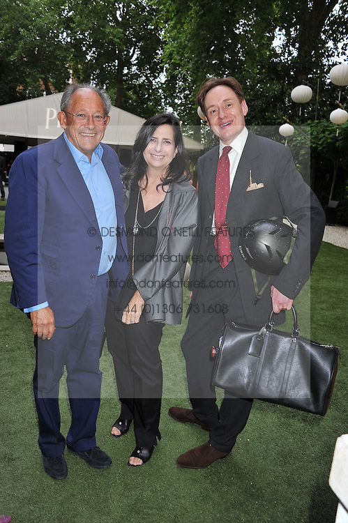 Left to right, MARCUS & SALLY-ANNE MARGULIES and NICK FOULKES at a garden party hosted by Piaget at The Hempel Hotel, London on 14th July 2011.