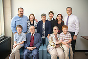 Dr Hwa- Wei Lee (Front Row Center Left) with his family at Alden Library. Photo by Ben Siegel