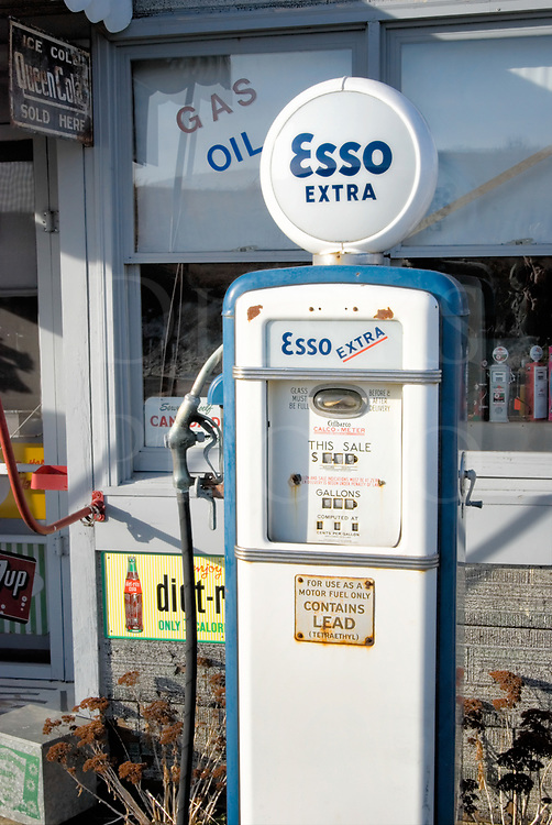 Vintage Esso leaded gas pump in blue paint trim, classic roadside Americana from the 1960's.