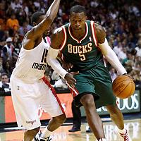 22 January 2012: Milwaukee Bucks shooting guard Stephen Jackson (5) drives past Miami Heat point guard Mario Chalmers (15) during the Milwaukee Bucks 91-82 victory over the Miami Heat at the AmericanAirlines Arena, Miami, Florida, USA.