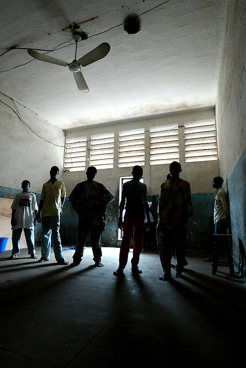 Prisoners at the interior of their dormitory, Cotonou, Benin september 2003 - The prison of Cotonou has a part reserved for the young criminals. Many of these young criminals are street children who consume drugs.  They have been put in prison for the use, possession and/or trade of drug; and also often for violence and rape. Visiting room.