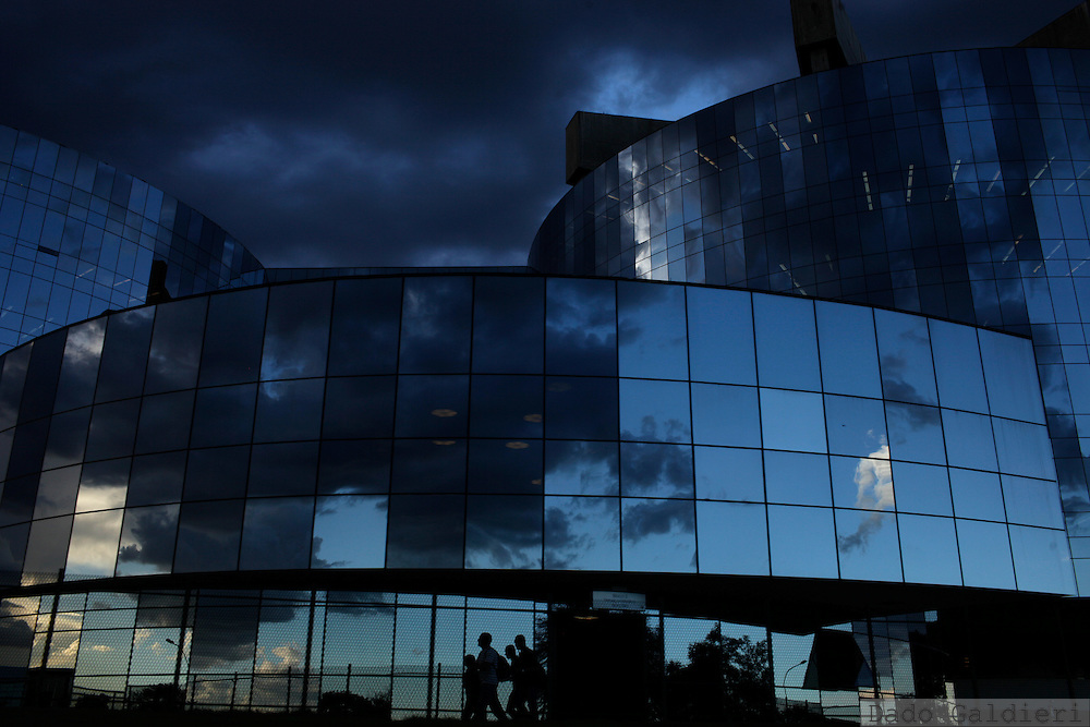 Workers walk around the all glass windows towers of Attorney General's offices in Brasilia, Brazil, Wednesday, Feb 8, 2012.(Photo Dado Galdieri)