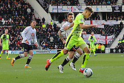 Huddersfield Town forward Jamie Paterson heads for goal during the Sky Bet Championship match between Derby County and Huddersfield Town at the iPro Stadium, Derby, England on 5 March 2016. Photo by Aaron Lupton.