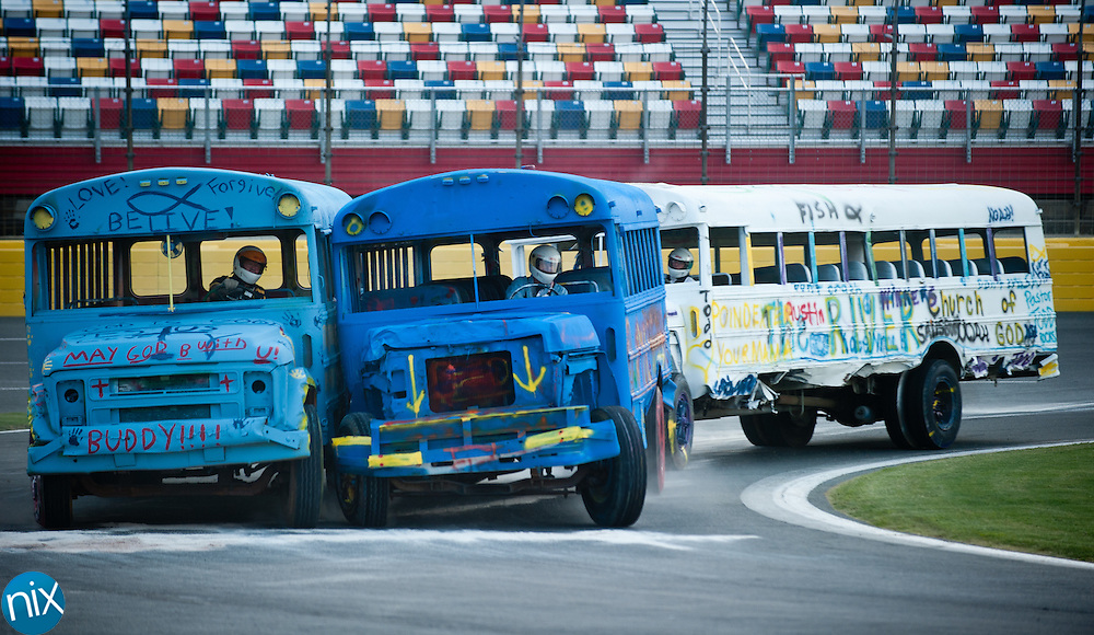 School bus racing during the second night of the Summer Shootout at Charlotte Motor Speedway Tuesday night. The summer racing series will go on through July.  (Photo by James Nix)