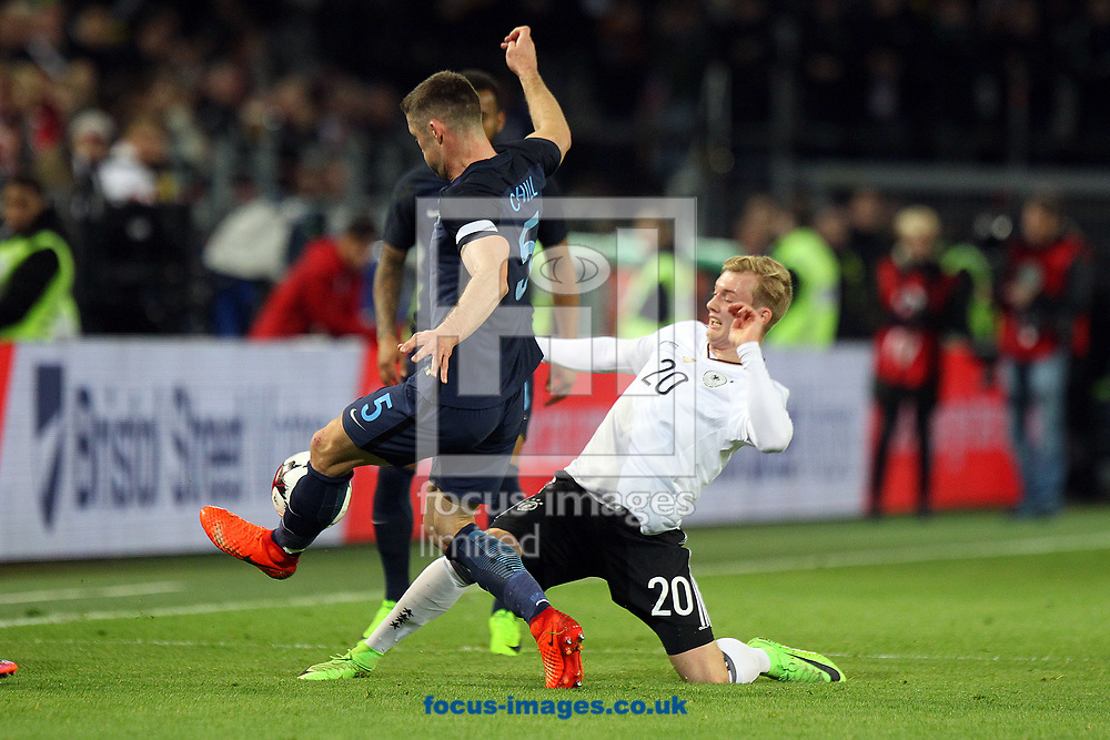 Gary Cahill of England and Julian Brandt of Germany in action during the International Friendly match at Signal Iduna Park, Dortmund<br /> Picture by Paul Chesterton/Focus Images Ltd +44 7904 640267<br /> 22/03/2017