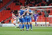 Wigan Athletic Players Celebrate No 9 Will Grigg Goal,Its 0-1 To Wigan  during the Sky Bet League 1 match between Doncaster Rovers and Wigan Athletic at the Keepmoat Stadium, Doncaster, England on 16 April 2016. Photo by Stephen Connor.