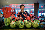 DUBAI, UAE - DECEMBER 18, 2015: Alcoholic cocktails are being served in cut watermelons at Saffron restaurant, West Tower, Atlantis The Palm, The Palm Jumeirah.