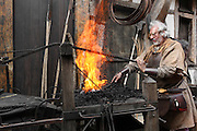 Scene of a blacksmith at work in the Middle Ages stoking his fire. Image taken from the filming of 'Paris la ville a remonter le temps' written by Carlo de Boutiny and Alain Zenou, directed by Xavier Lefebvre, a Gedeon Programmes production. Picture by Manuel Cohen