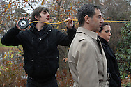 "December 5, 2009- Second Assistant Camera, junior Evan Stulc, measures the distance between the actors Scott Winters and Jojo Marino and the camera, so that he is able to determine the proper focus before shooting a scene on the set of ""The Last Laugh"" at Mount Auburn Cemetery in Cambridge, MA."