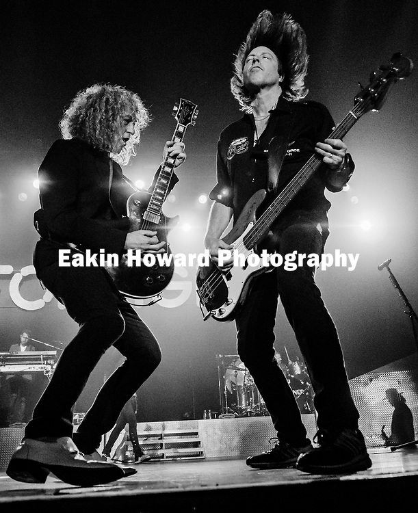 Foreigner's Bruce Watson, on electric guitar, and Jeff Pilson, on bass, play on the stage of the Thomas Wolfe Auditorium in the U.S. Cellular Center in Asheville, NC on Feb. 22, 2017.