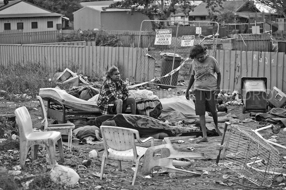 Jennifer (pseudonom) and Jacquelin waking up<br />in a homeless camp outside the fence around the<br />Mallingbarr (Kennedy Hill) community. The condemned<br />house they used to squat in was demolished. Broome, Western Australia