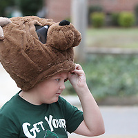 Buddy Brown, 11, of Nettleton takes a peek from under his bear costume as he and hundreds of other children enjoy the annual Trunk or Treat event along Jefferson Street in Tupelo Tuesday night.
