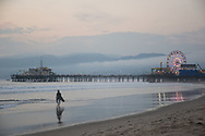Photo sunset Santa Monica Pier Wall art. Surfer, Ferris Wheel, water reflections, beach. Los Angeles, Westside, Southern California ocean landscape photography. Matted print, limited edition. Fine art photography print.