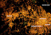 City's By Night<br /> <br /> Shanghai At Night: A Growing City<br /> <br /> The city of Shanghai sits along the delta banks of the Yangtze River along the eastern coast of China. The city proper is the world' most populous city (the 2010 census counts 23 million people, including 'registered' residents). With that many humans, the city is a tremendous sight at night. Shanghai is a key financial capital for China and the Asian Pacific region. The bright lights of the city center and the distinctive new skyscrapers that form the skyline along the Pudong district (the eastern shore of the Huangpu River, a tributary of the Yangtze that cuts through the center of Shanghai) make for spectacular night viewing both on the ground and from space.<br /> ©Earth Observatory/Exclusivepix