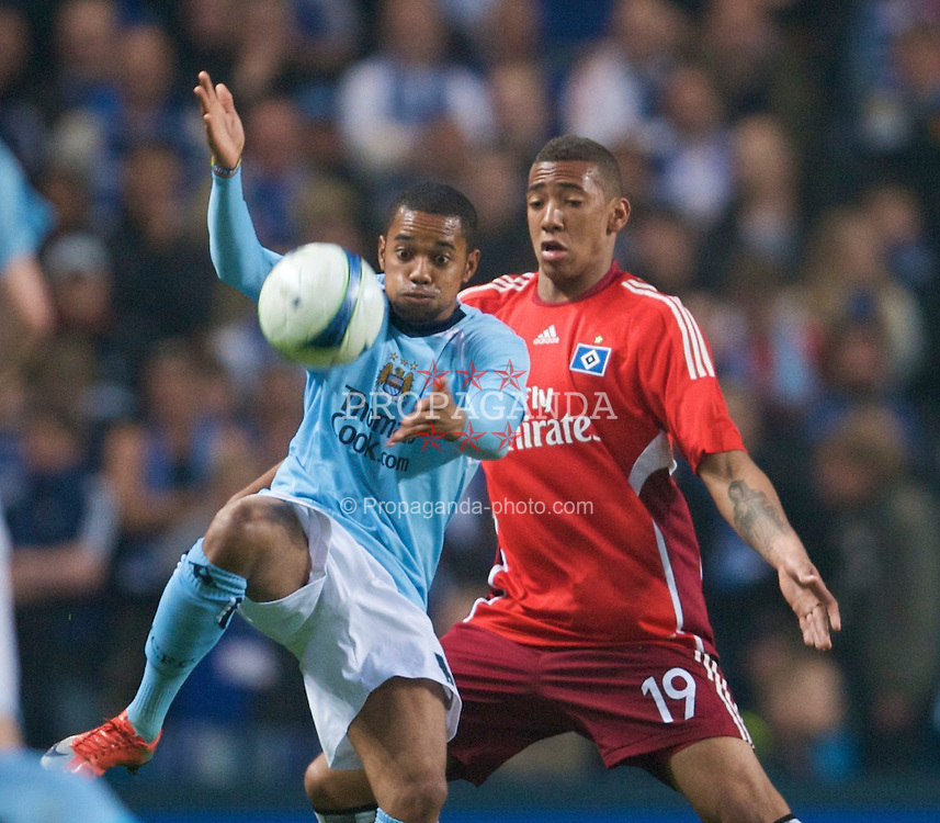 MANCHESTER, ENGLAND - Thursday, April 16, 2009: Hamurger SV's Jerome Boateng and Manchester City's Robinho during the UEFA Cup Quarter-Final 2nd Leg match at the City of Manchester Stadium. (Pic by David Rawcliffe/Propaganda)