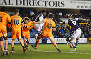 Millwall FC Defender Byron Webster puts Millwall 3 up to make the score 4-1 during the Sky Bet League 1 match between Millwall and Colchester United at The Den, London, England on 21 November 2015. Photo by Andy Walter.